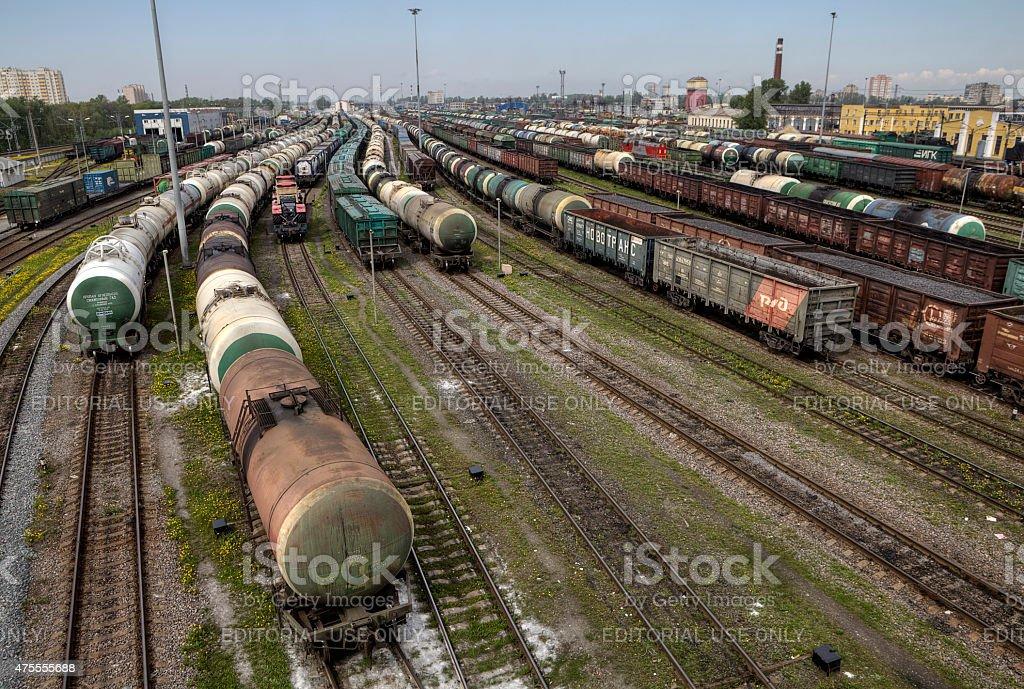 Oil tank and trains on railroad tracks, classification yard, Russia. stock photo