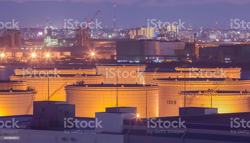 Oil tank at industrail zone and high building stock photo