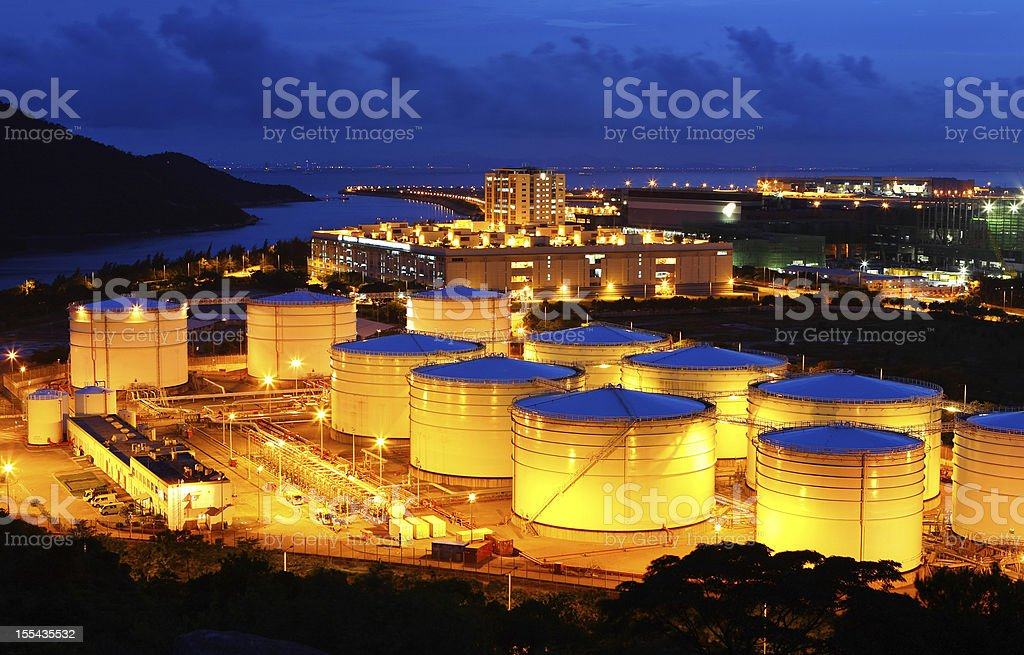 oil tank at night stock photo