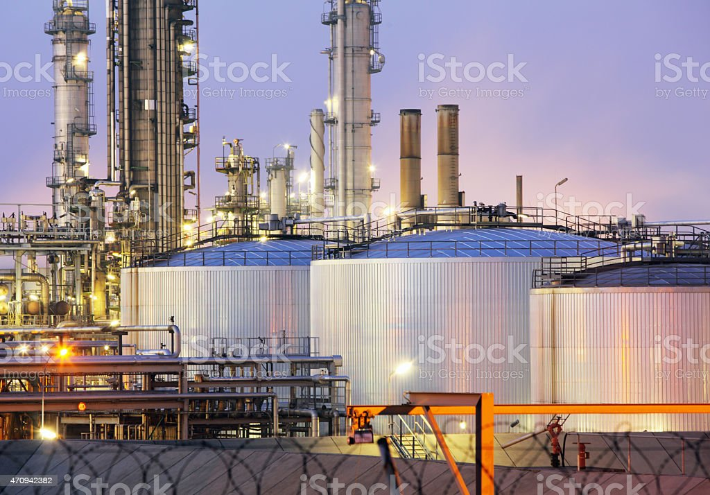 oil tank at night stock photo