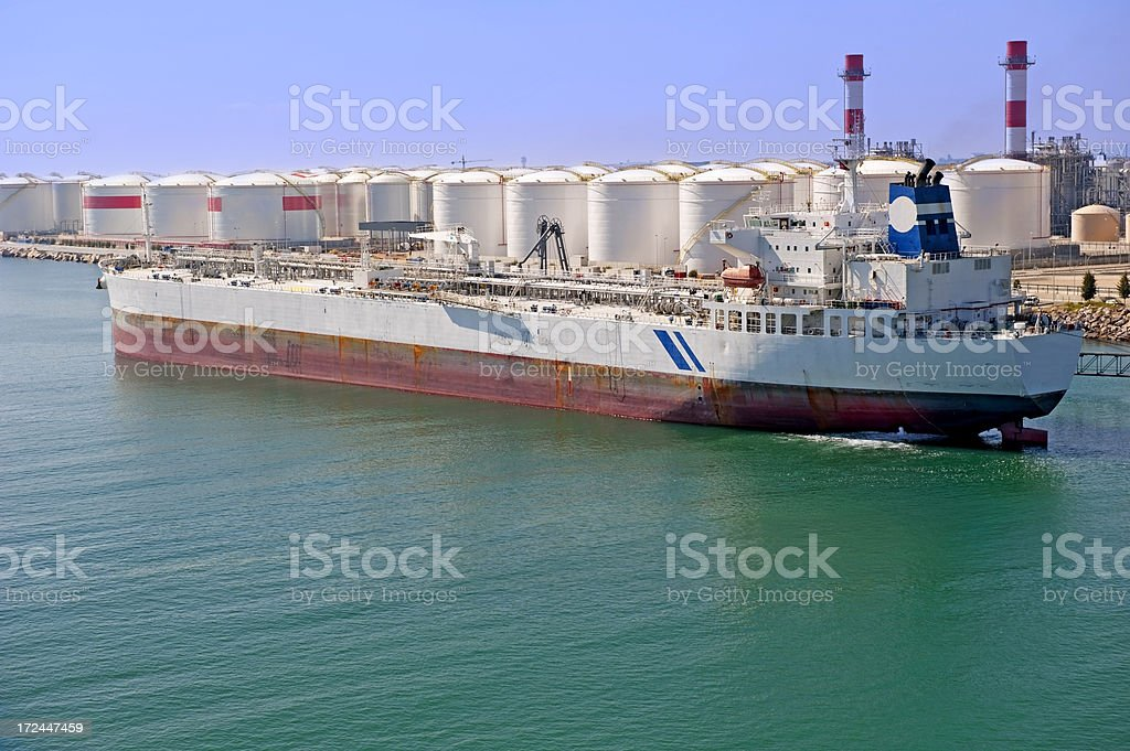 Oil tank ship arriving at port stock photo