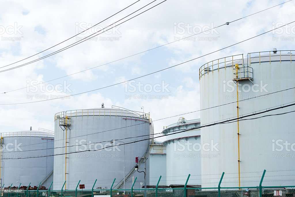 Oil tank with cloud sky stock photo