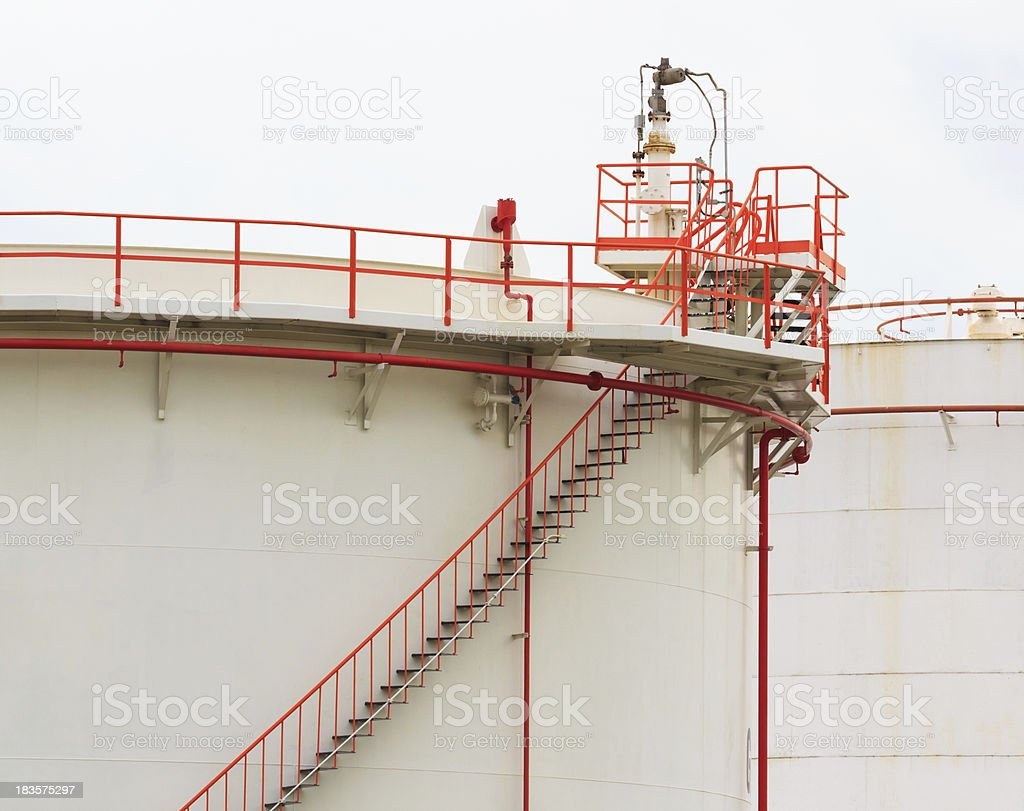 Oil Tank with Vivid Color Pipe and Staircase, White Background royalty-free stock photo