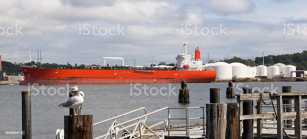 Oil Tanker and storage tanks royalty-free stock photo