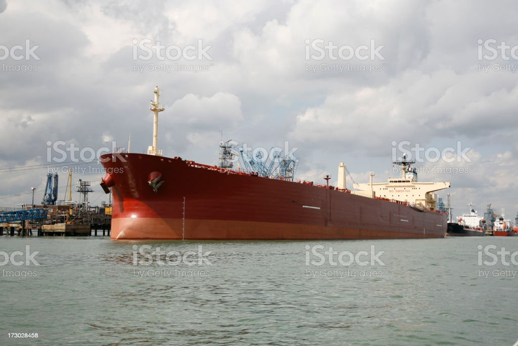 Oil tanker at a refinery royalty-free stock photo