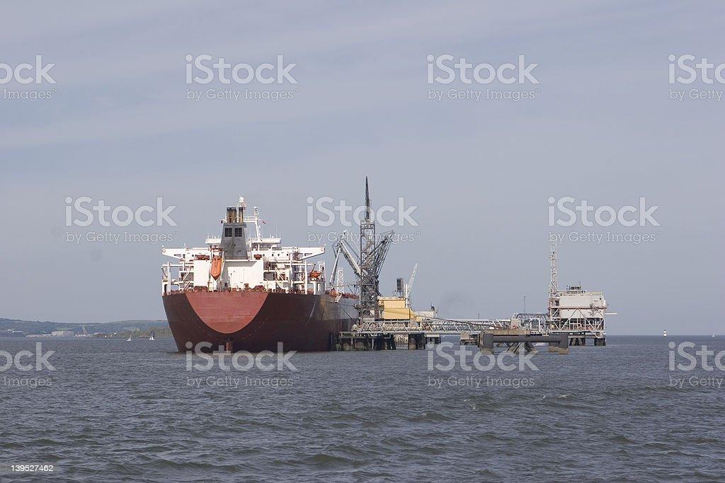 Oil tanker at platform royalty-free stock photo
