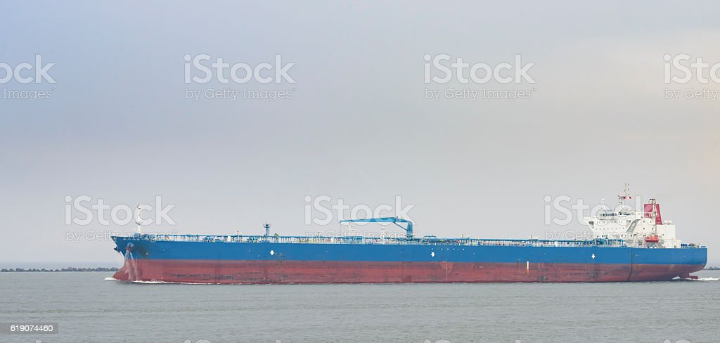 Oil tanker heading for open sea stock photo