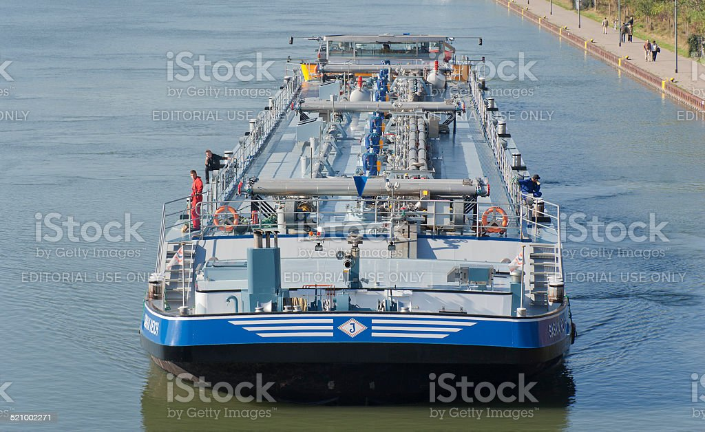 Oil Tanker on canal stock photo