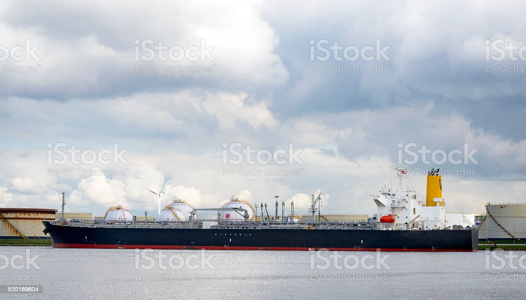 Oil tanker ship in port stock photo