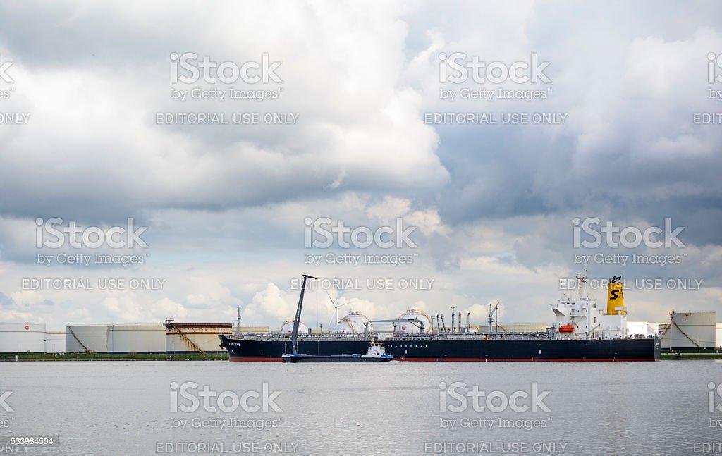 Oil tanker ship in port stock photo