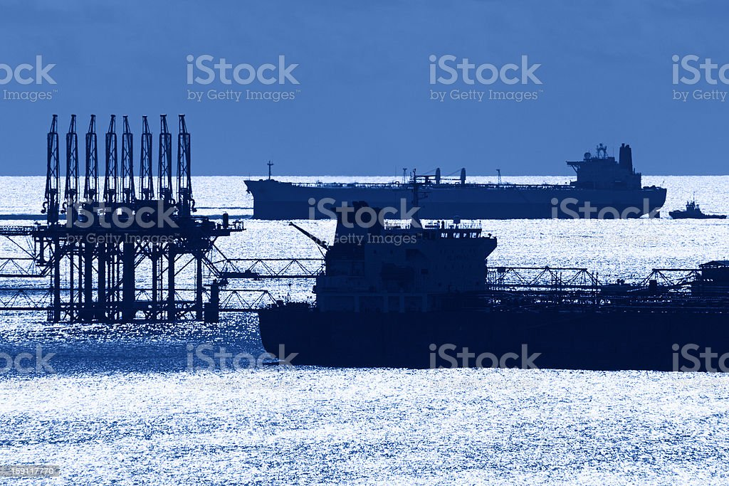 Oil tanker silhouette on the ocean royalty-free stock photo