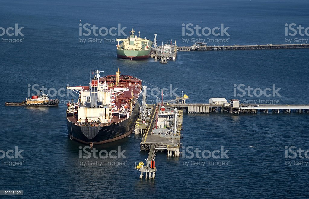 Oil tankers docked in the middle of the ocean stock photo