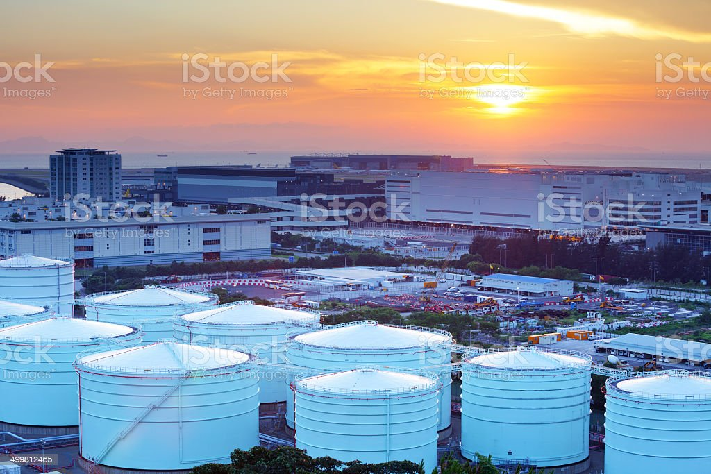 Oil tanks for cargo service during sunset stock photo