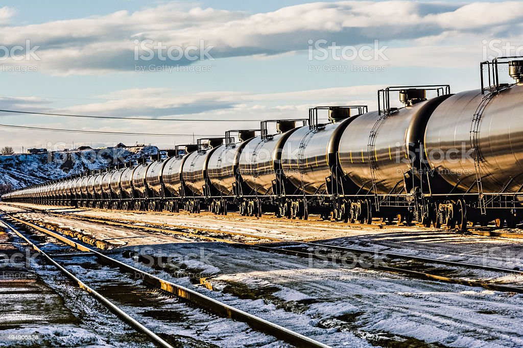 Oil train passing through a Montana railyard from North Dakota stock photo