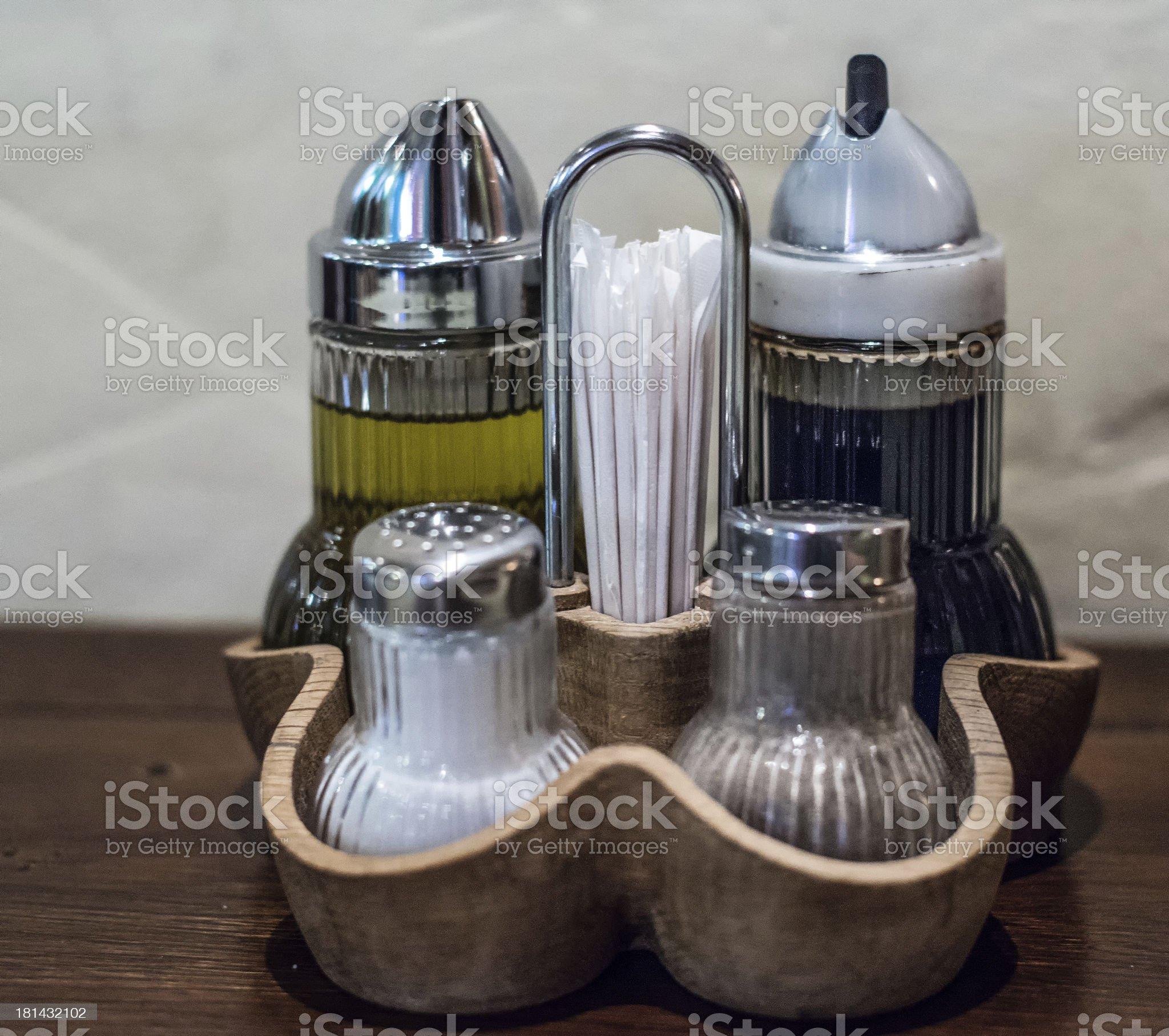 Oil, vinegar, salt and black pepper royalty-free stock photo