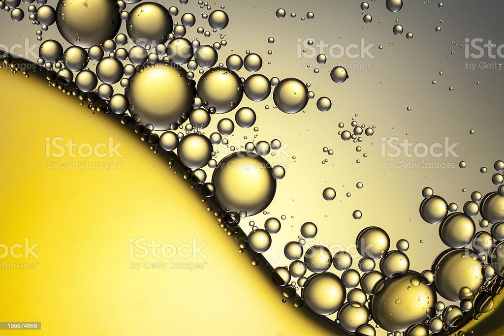 Oil & Water - Abstract Background Yellow Gold Macro royalty-free stock photo