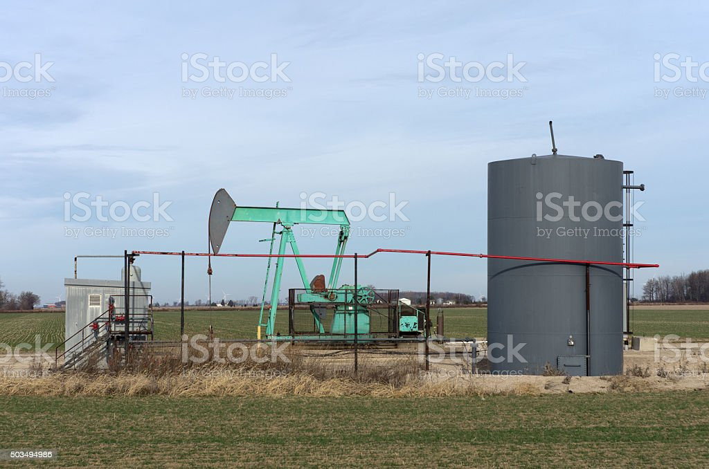 Oil Well and Wind Turbines stock photo