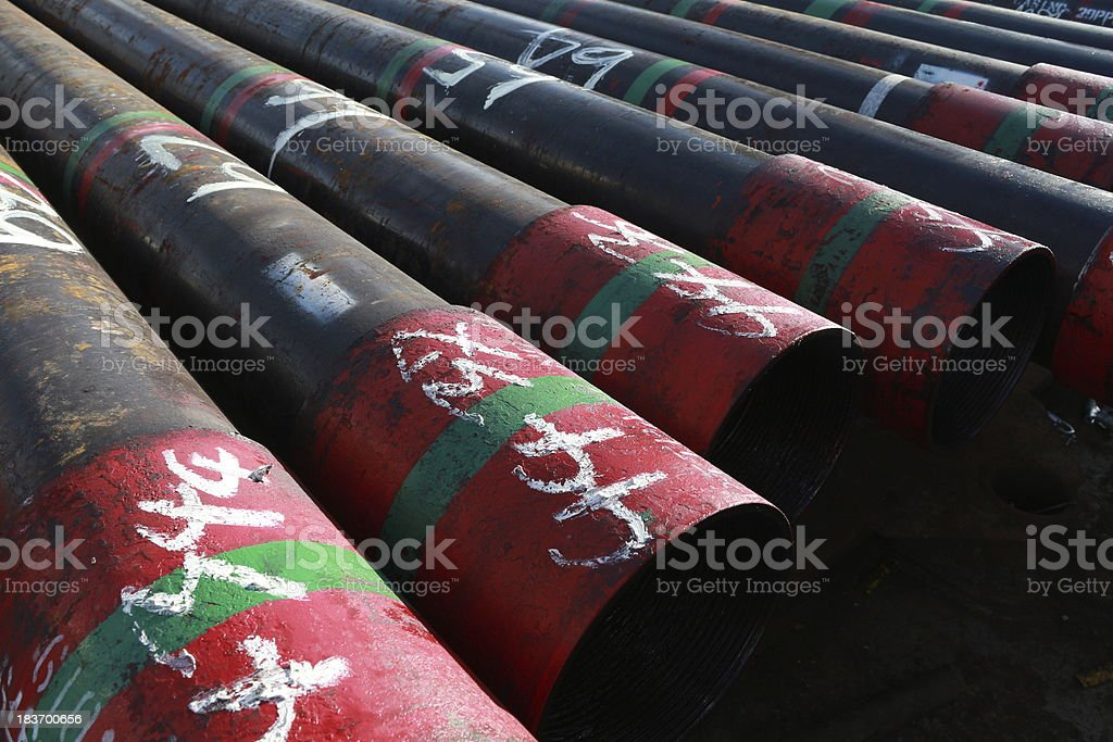 Oil well casing laying on the main deck royalty-free stock photo