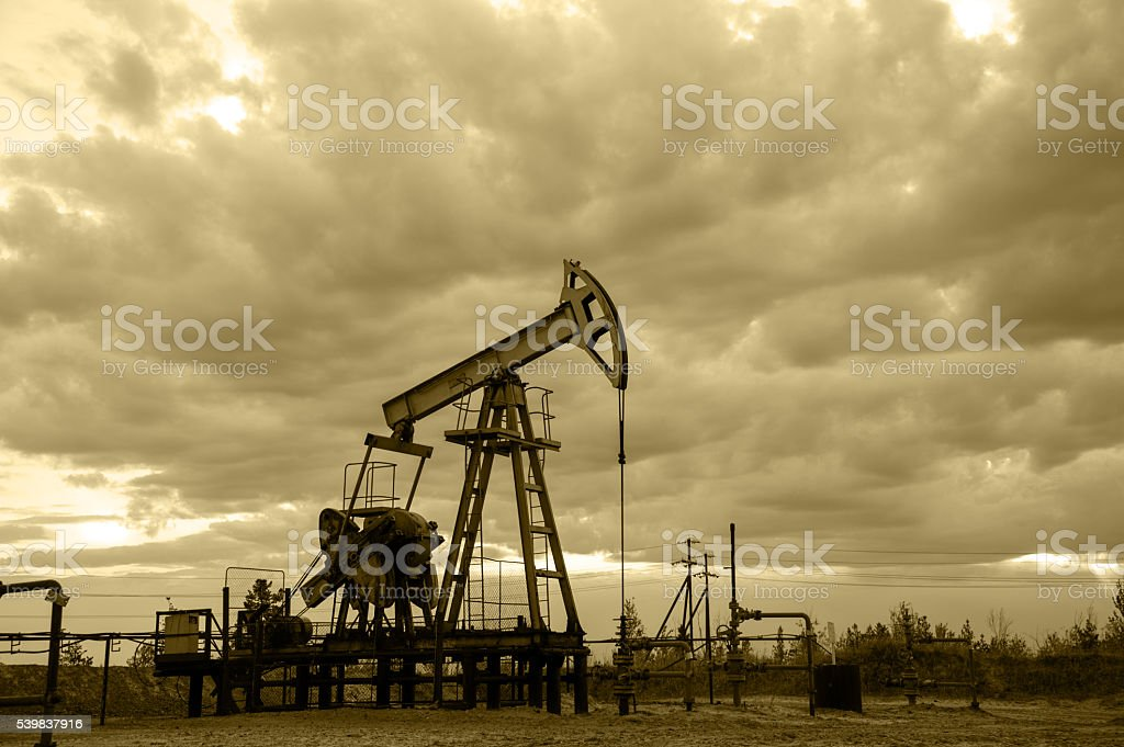 Oil well pump. Monochrome. stock photo