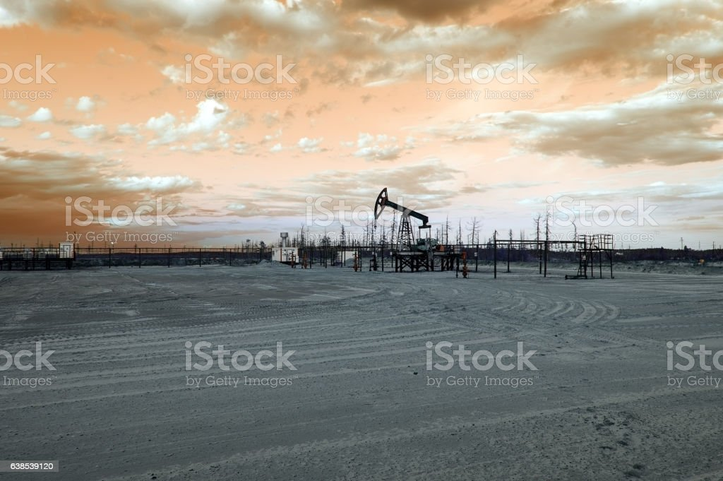 Oil well pump. Toned. stock photo