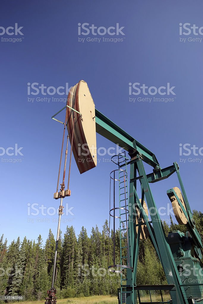 oil well pumper in rural setting stock photo