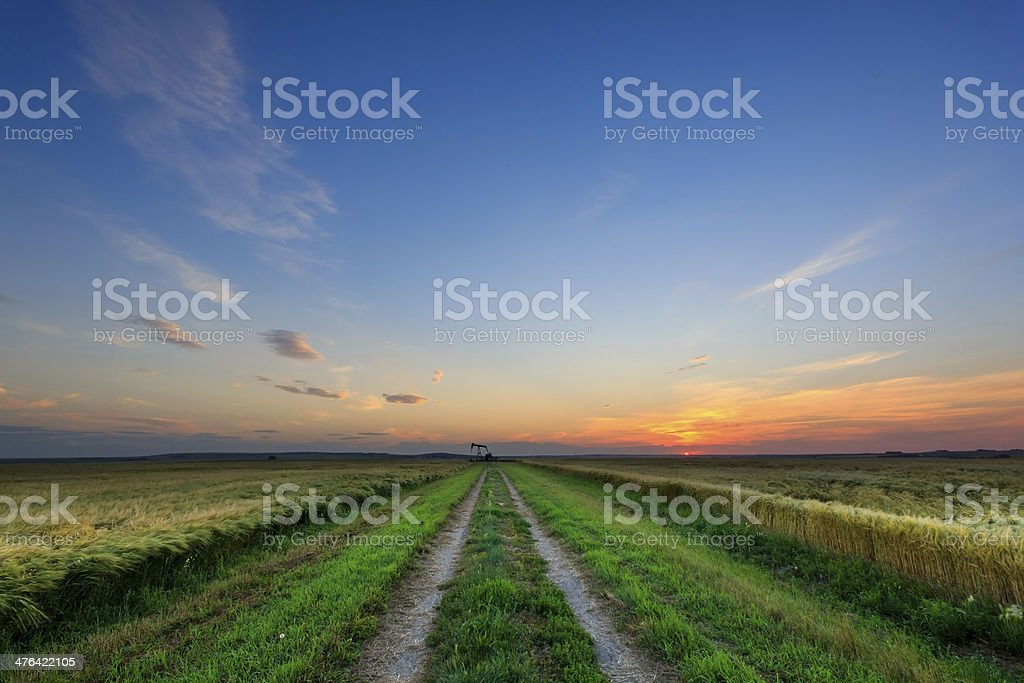 Oil Well Road Sunset royalty-free stock photo