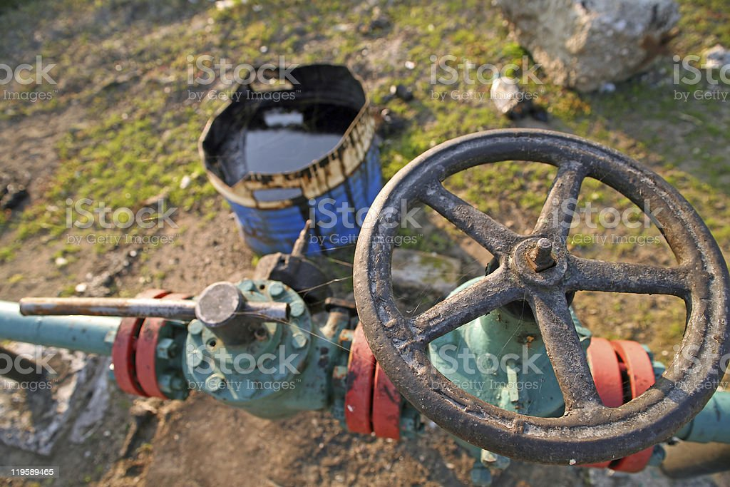 Oil wells valve with pollution royalty-free stock photo