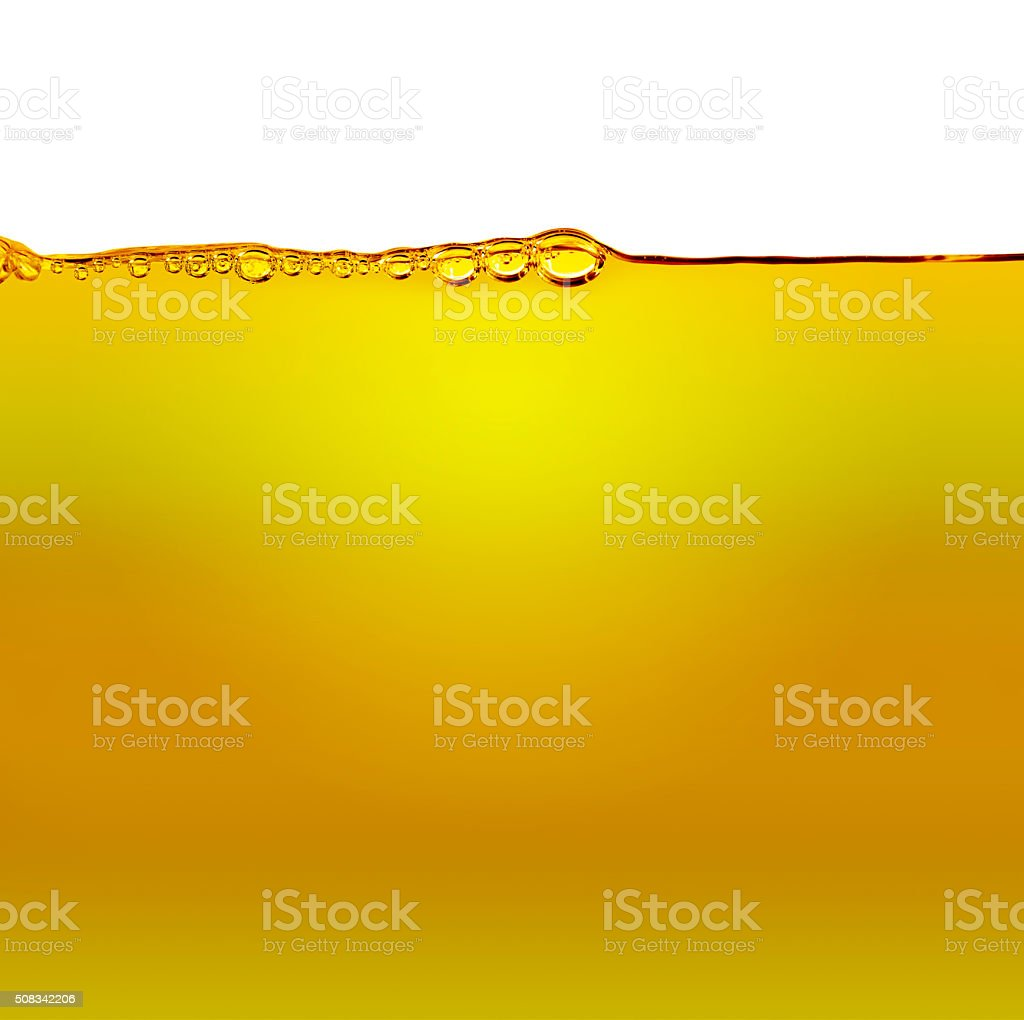 Oil with air bubbles at the white stock photo