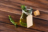 Oil with dry leaves of rosemary