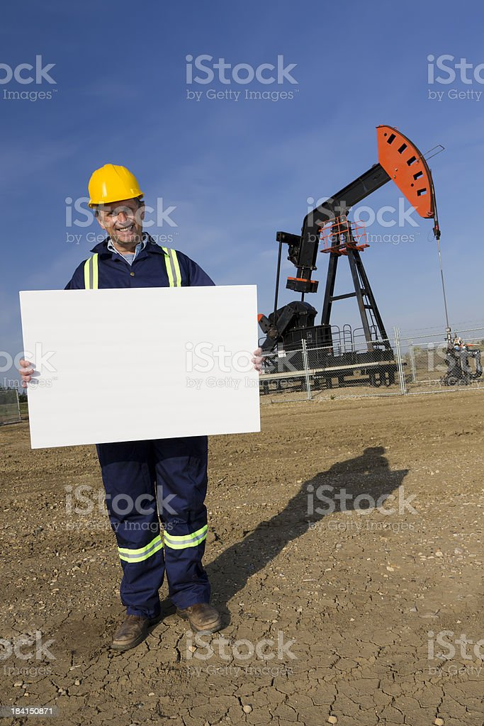 Oil Worker and Blank Sign royalty-free stock photo
