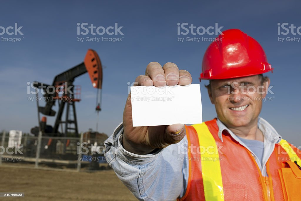 Oil Worker and Business Card stock photo