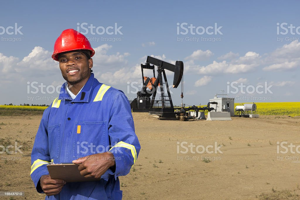 Oil Worker and Clipboard stock photo