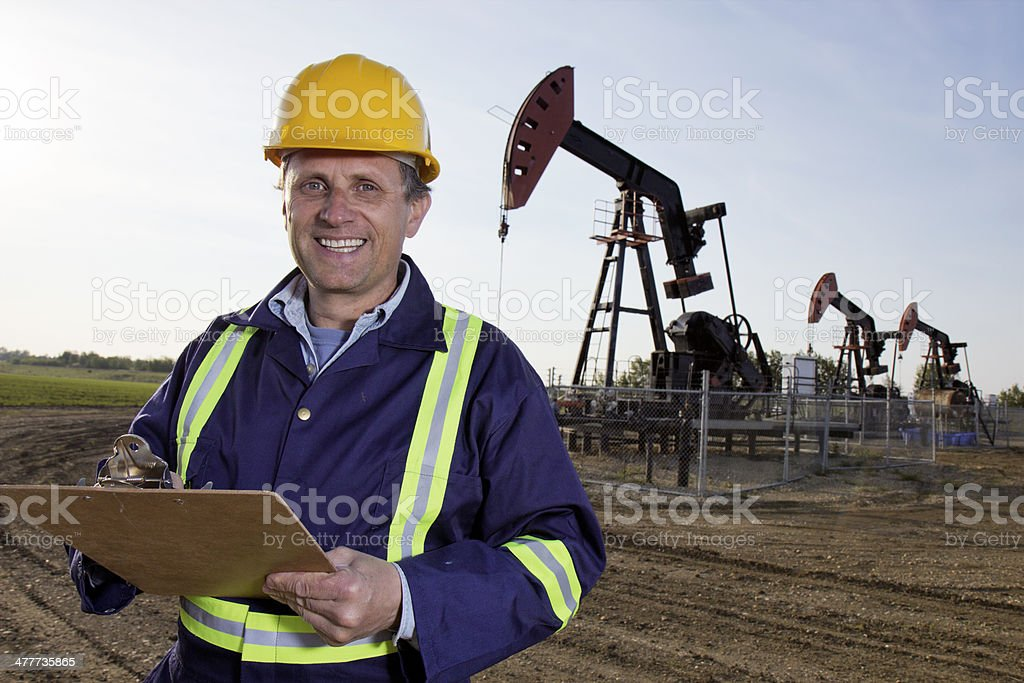 Oil Worker and Clipboard royalty-free stock photo