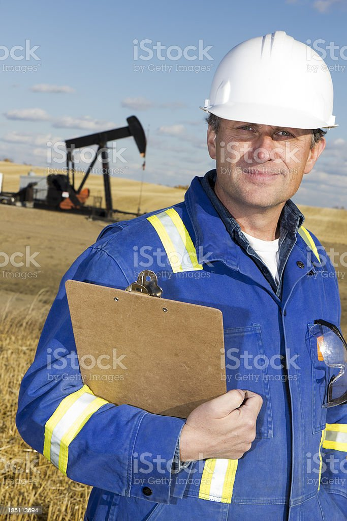 Oil Worker and Derrick royalty-free stock photo