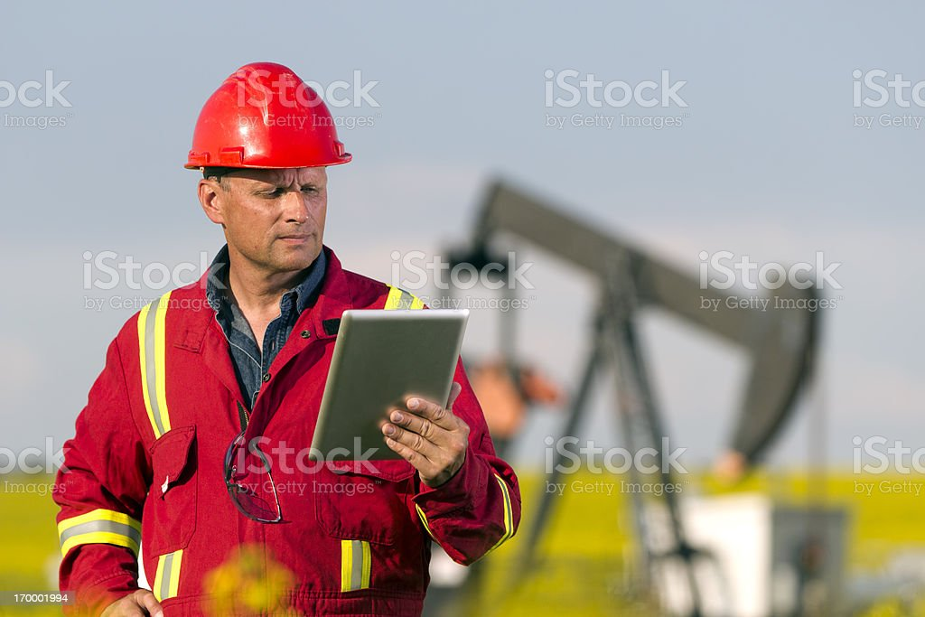Oil Worker and Internet stock photo