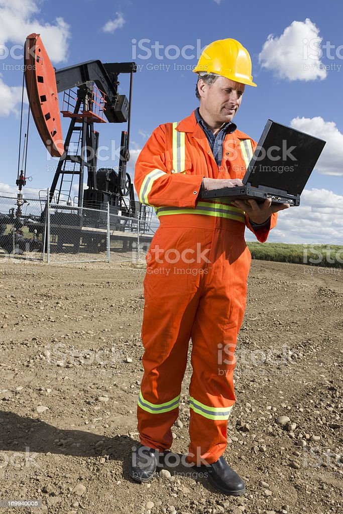Oil Worker and Laptop royalty-free stock photo
