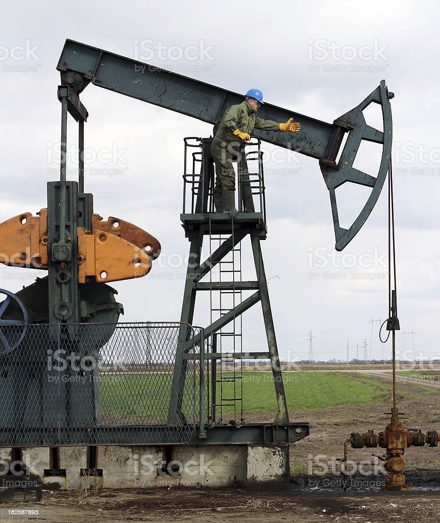 oil worker and pump jack royalty-free stock photo