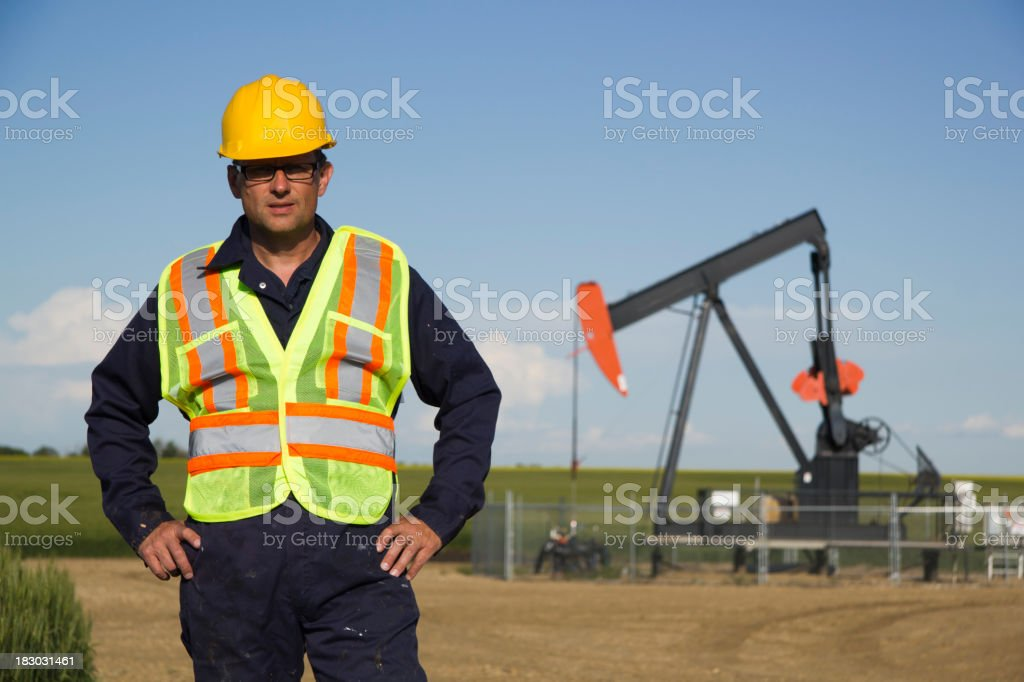 Oil Worker and Pumpjack stock photo