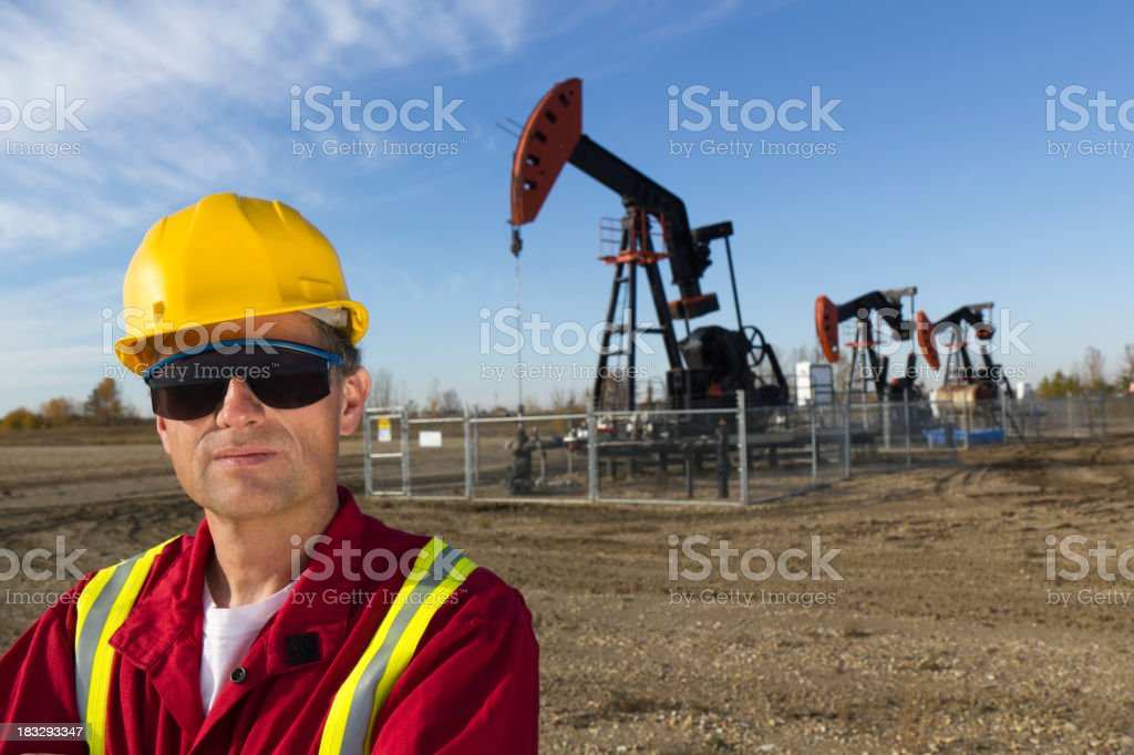 Oil Worker and Three Jacks stock photo