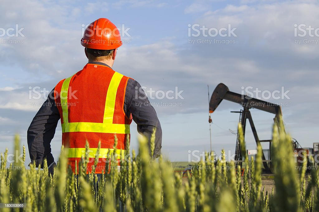 Oil Worker and Well royalty-free stock photo