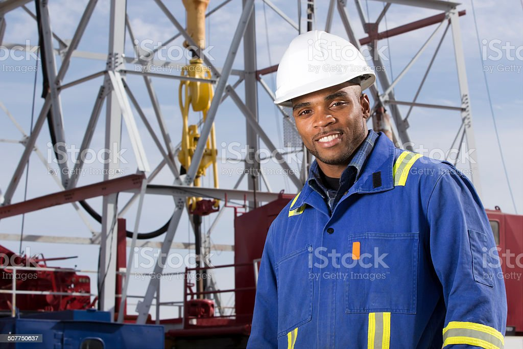 Oil Worker at a Rig stock photo