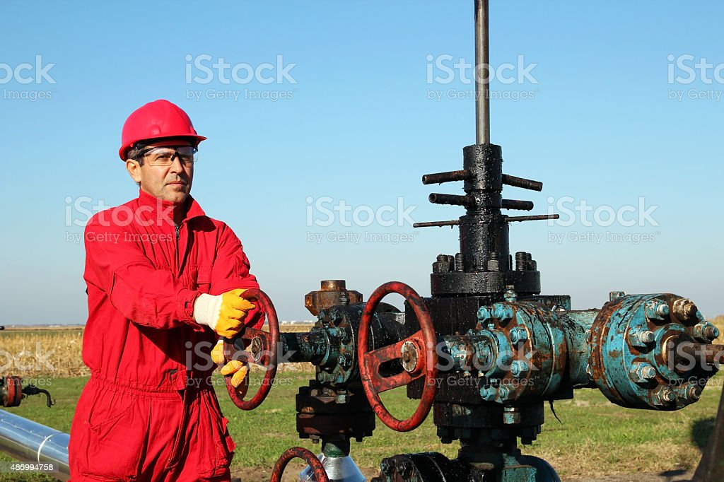 Oil Worker at Drilling Rig stock photo