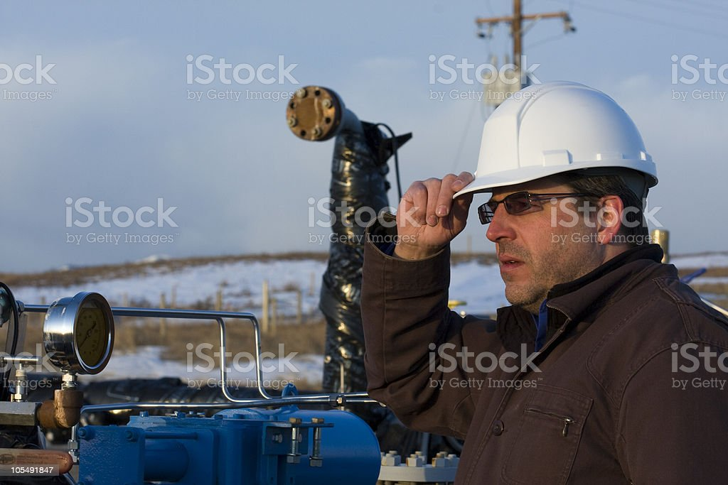 Oil Worker at Gauge royalty-free stock photo
