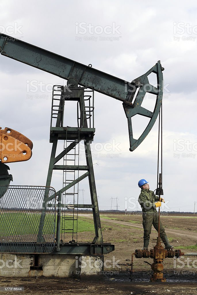 oil worker check pumpjack royalty-free stock photo