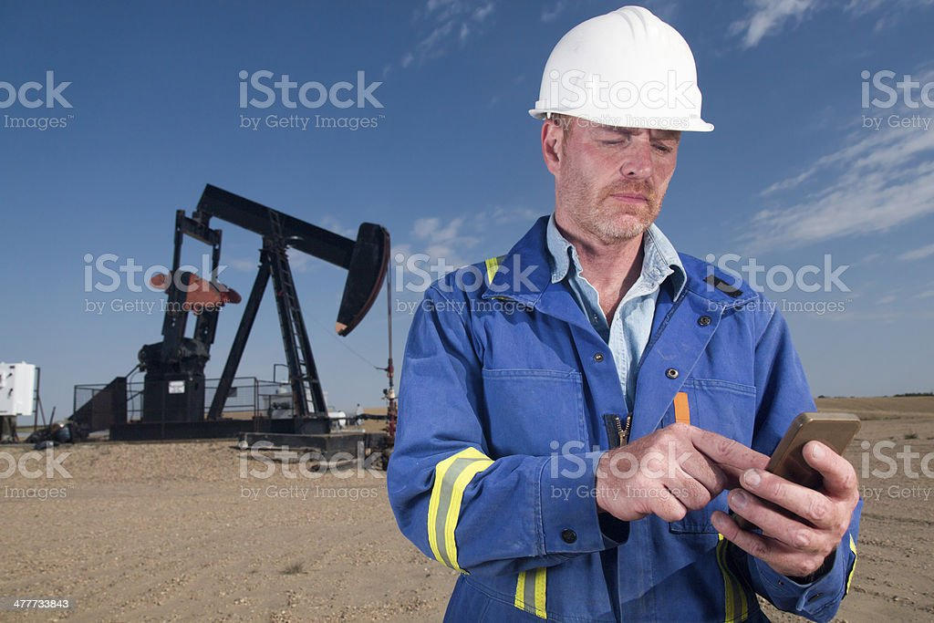 Oil Worker Checking Email royalty-free stock photo