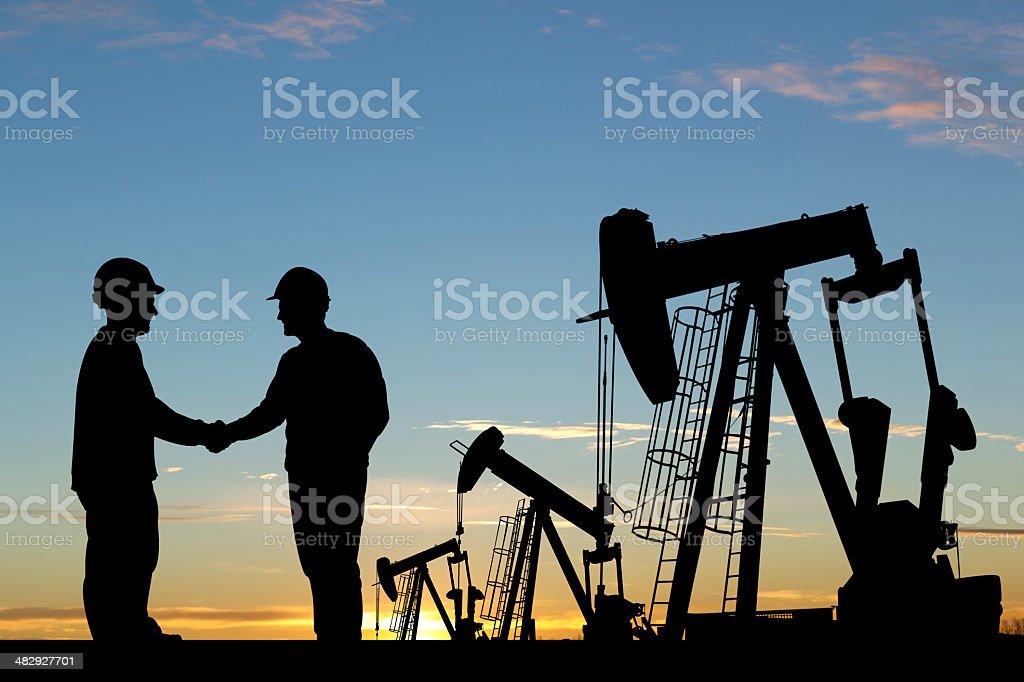 Oil Worker Handshake royalty-free stock photo