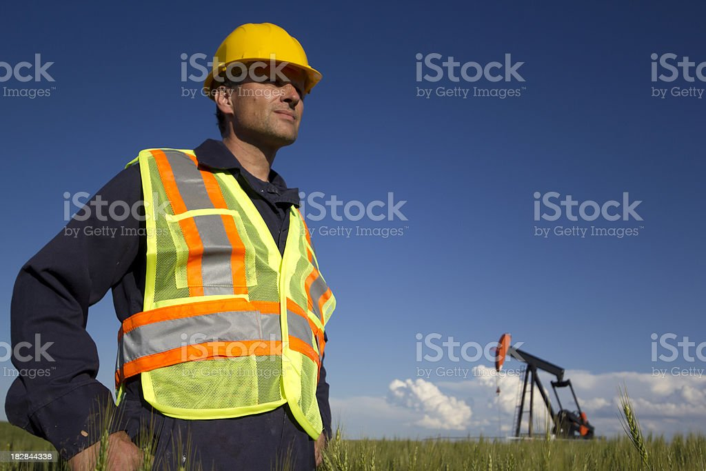 Oil Worker in a Field royalty-free stock photo