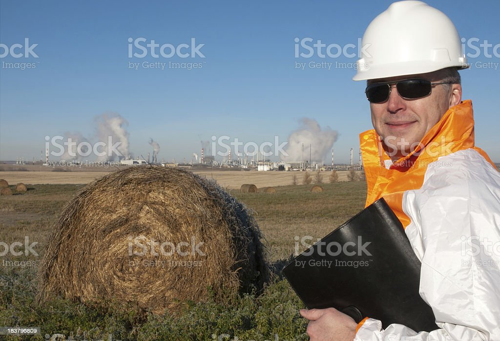 Oil Worker in Safety Gear With PetroChem Plant royalty-free stock photo
