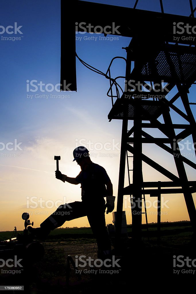 Oil worker silhouette royalty-free stock photo