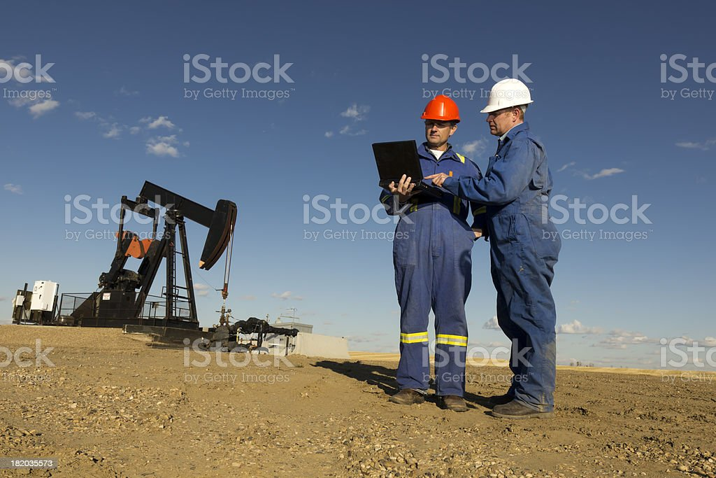 Oil Workers and Computer royalty-free stock photo